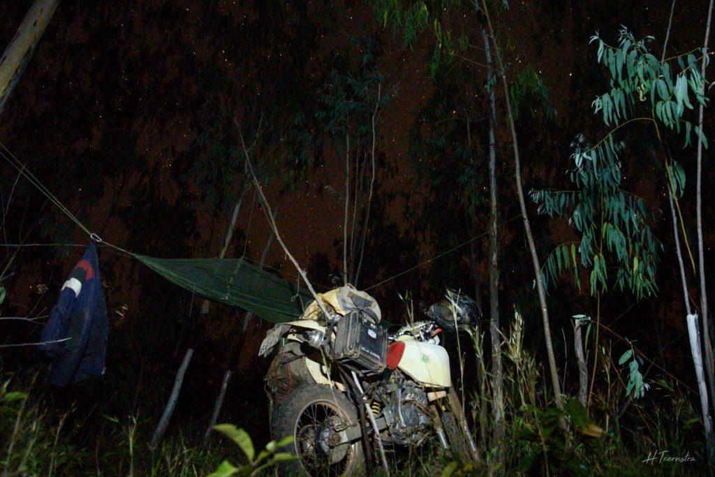 Night time bush camp motorcycle hammock